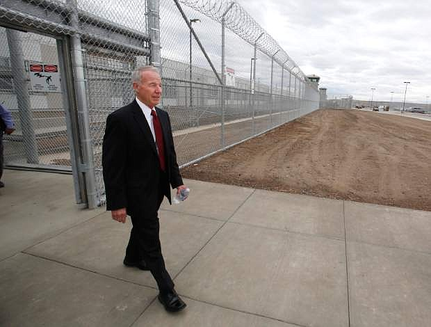 FILE - In this photo taken Tuesday, June 25, 2013, Corrections Secretary Jeffrey Beard walks into the new California Correctional Health Care Facility, in Stockton, Calif.  California inmates have ended a nearly two-month hunger strike to protest the prison system's isolation policies, prison officials said Thursday, Sept. 5, 2013. More than 30,000 inmates had been refusing meals when the strike began in early July. By this week the number had dwindled to 100 strikers, including 40 who had been on strike continuously since July 8. (AP Photo/Rich Pedroncelli, file)