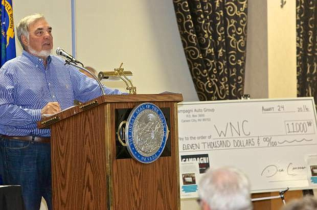 Dick Campagni presents an $11,000 check to WNC Wednesday morning at the NNDA August Breakfast at the Carson Nugget.