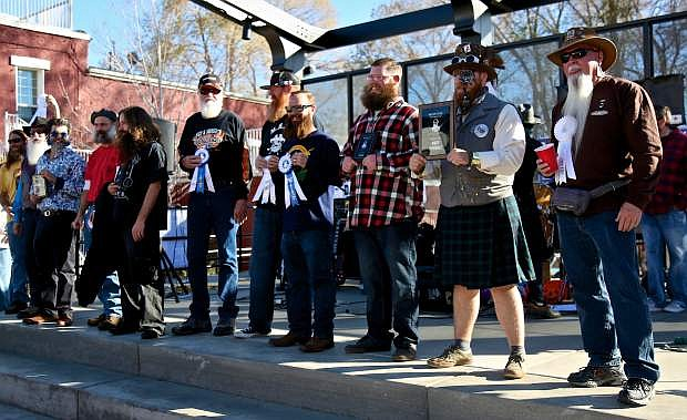 Winners of this year's beard contest take the stage at the end of the competition Saturday in McFadden Plaza.