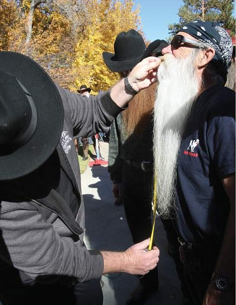 Carson City resident Michael Scott Cain has his beard measured at the Nevada Day Beard Contest on Saturday.