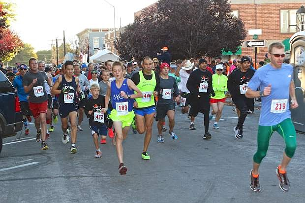 Nevada Day 2-mile and 8k runners leave the starting line Saturday in Telegraph Square.