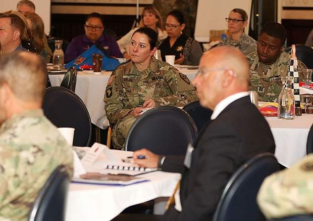 Nevada National Guard Maj. Christy Hales listens to a speaker at the Beyond the Yellow Ribbon Invitational Summit Wednesday morning at the Governor's Mansion. The summit was to help collaborate and share ideas for how to reduce military and veteran unemployment across the country.