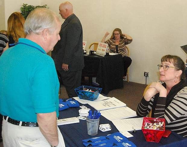 Although unemployment has declined in the county, a job fair held in November placed job seekers with emlpyers such as Lisa Gonzales from Manpower, right.