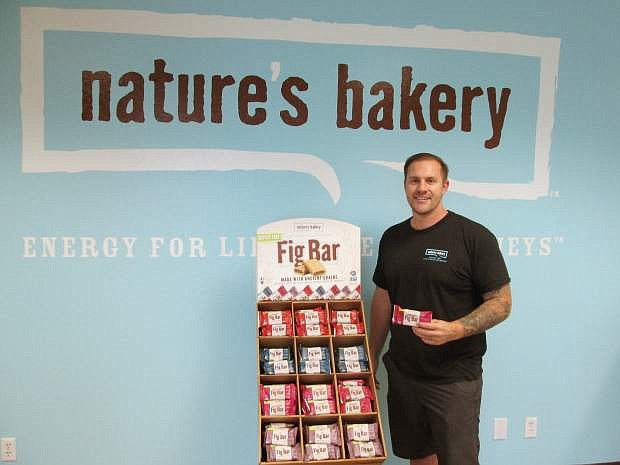Sam Marson at the reception area of the company's warehouse. Fig bar samples are always on offer for visitors.