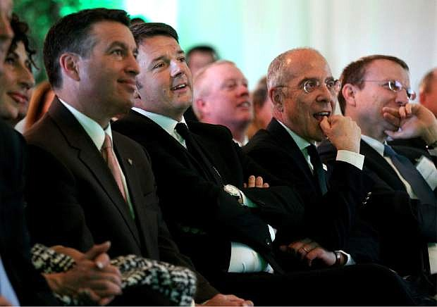 Nevada Gov. Brian Sandoval, left, Italy's Prime Minister Matteo Renzi, second from left, Enel CEO Francesco Starace and Enel Green Power CEO Francesco Venturini attend an inauguration ceremony at Enel Green Power North America Inc.'s Stillwater Geothermal Plant near Fallon, Nev., on Tuesday, March 29, 2016. The facility is the only geothermal power plant in the world that combines geothermal energy with two kinds of solar technology. (AP Photo/Cathleen Allison)