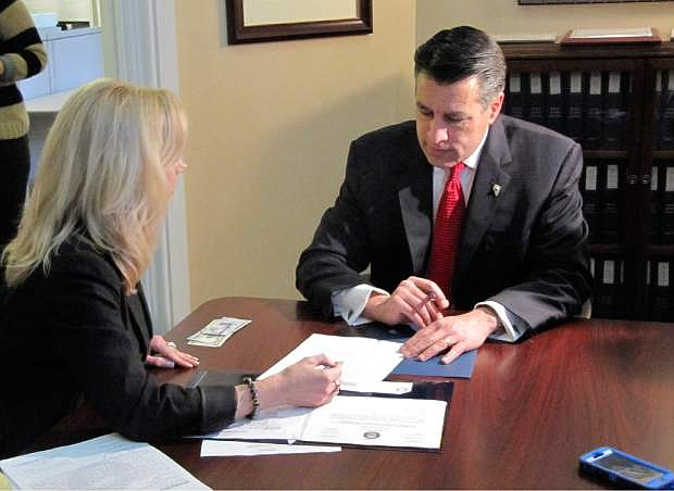 Gov. Brian Sandoval said last week he and his staff are aware the budget frowingmore than what state coiffers are taking in.