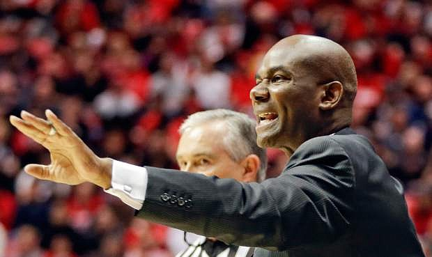 Nevada coach David Carter calls to his team during the first half of an NCAA college basketball game against San Diego State, Saturday, Feb. 8, 2014, in San Diego. (AP Photo/Lenny Ignelzi)