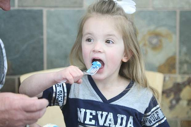 Three-year-old Ryleigh Cates samples some Battle Born Birthday Cake on Friday at Carson Tahoe Regional Medical Center during the Nevada 150 event.