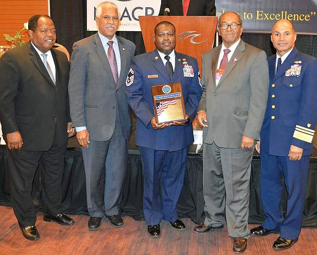 Senior Master Sgt. Torry Thompson of the Nevada Air National Guard receives on July 22  the Roy Wilkins Renowned Service Award at the 2014 National Association for the Advancement of Colored People (NAACP) 39th Annual Armed Services and Veterans Affairs Awards Luncheon in  Las Vegas.