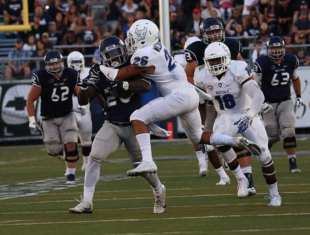 James Butler carries Ryan Wiliamson on a long game for Nevada Saturday.