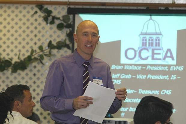 Brian Wallace, president of the Ormsby County Education Association speaks to new school district teachers at a luncheon on Monday.