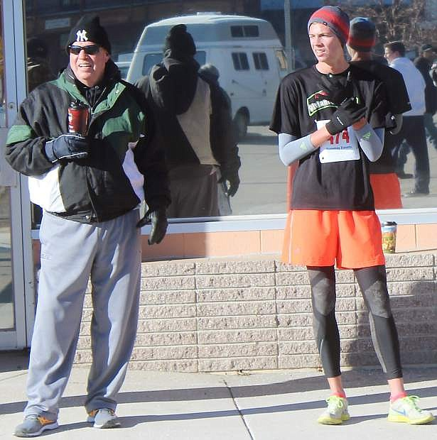 Tristen Thomson, left, stands with his father Thommy Thomson after the New Year's Day 5K Run/Walk.