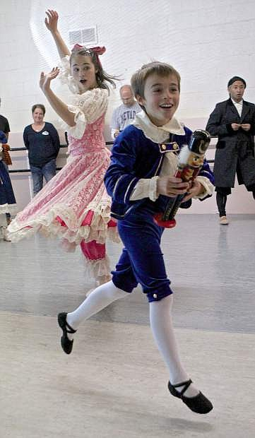 Jayse Gillot, 11, steals the Nutcracker from his sister Maddie, 15, during rehearsal on Saturday in Carson City.
