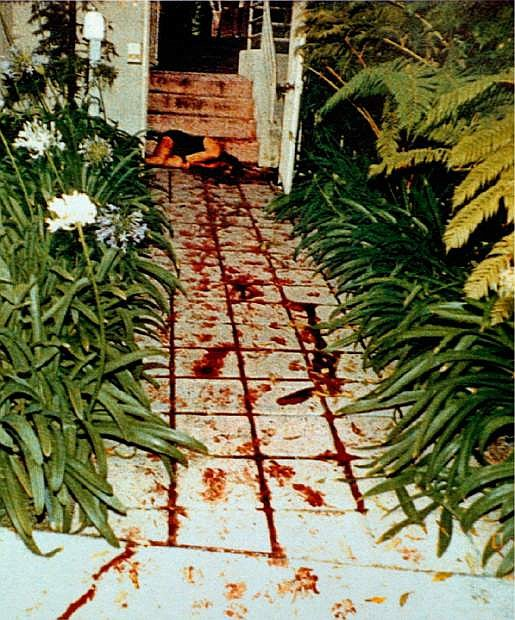 FILE: EDITORS: NOTE GRAPHIC CONTENT--The body of Nicole Brown Simpson is seen where she was found on the bloodstained walkway of her Bundy Drive condominium as seen in this LAPD evidence photo, introduced and accepted as evidence and released for publication, in the O.J. Simpson wrongful-death civil trial Friday, Oct. 25, 1996, in Superior Court in Santa Monica, Calif. Detectives are investigating a knife purportedly found some time ago at the former home of O.J. Simpson, who was acquitted of murder charges in the 1994 stabbings of his ex-wife Nicole Brown Simpson and her friend Ron Goldman, Neiman said Friday. (AP Photo/LAPD)