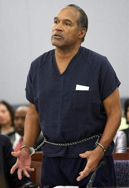File-This Dec. 5, 2008 file photo shows O.J. Simpson speaking during his sentencing  at the Clark County Regional Justice Center in Las Vegas. Simpson is heading back to the Las Vegas courthouse where he was convicted of leading five men in an armed sports memorabilia heist to ask a judge for a new trial because, he says, the Florida lawyer he paid nearly $700,000 botched his defense.  (AP Photo/Isaac Brekken, File)