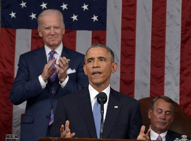 President Barack Obama delivers his State of the Union address to a joint session of Congress on Capitol Hill on Tuesday, Jan. 20, 2015, in Washington, as Vice President Joe Biden applauds and House Speaker John Boehner of Ohio, listens. (AP Photo/Mandel Ngan, Pool)