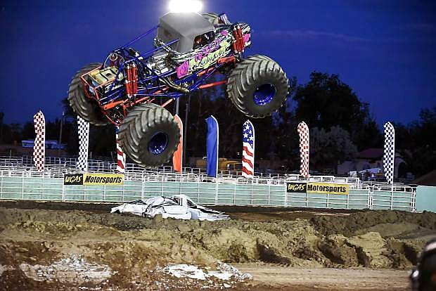 Wild Flower, driven by 18-year-old Rosalee Ramer, hit each jump on the Octane Fest course with more power and height than any other truck at Saturday's Octane Fest Monster Truck rally. Ramer is the youngest professional female monster truck driver.