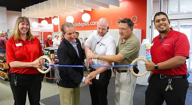 Taking part in a ribbon cutting ceremony at Office Depot on Tuesday are, from left, Carey Blakeley, Mayor Bob Crowell, Brad Nicholos, Assemblyman PK O'Neill and Rogelio Garcia.