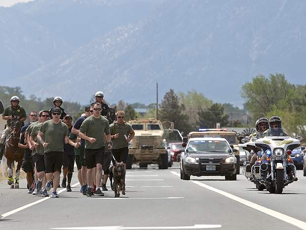 Carson City SWAT team members and other officers run north on Hwy. 395 Wednesday morning in memory of fallen officers.