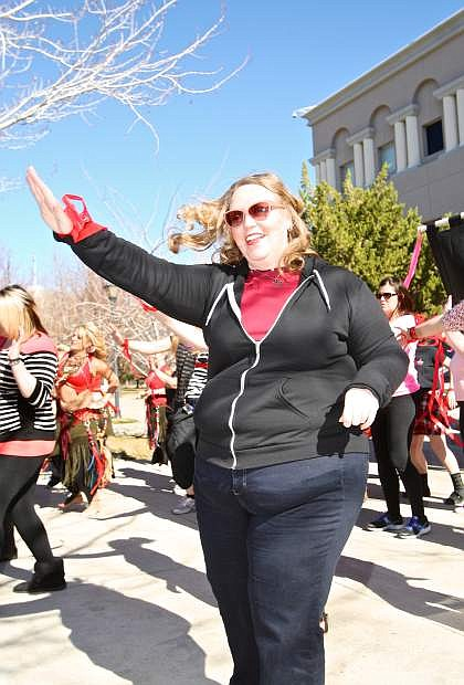 Deputy District Attorney Erica Jones participates in a dance at One Billion Rising, the largest mass action taking a stand against violence against women in front of the Nevada State Legislature building Saturday afternoon.