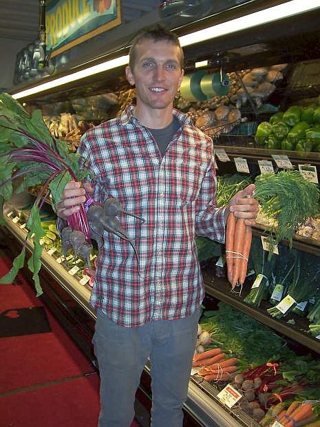Andrew Yokum, grocery buyer for Great Basin Community Food Co-op, shows organic produce at the shop. Many of the coop's suppliers will have to seek alternative organic certification before the Nevada Department of Agriculture certification program ends next year.