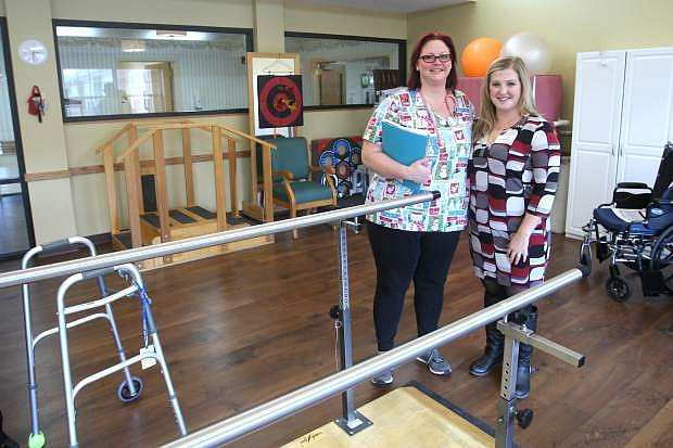Jillian Speegle, right, community relations director for Ormsby Post Acute Rehab and registered nurse Karri Montgomery pose in the center's new physical therapy room.