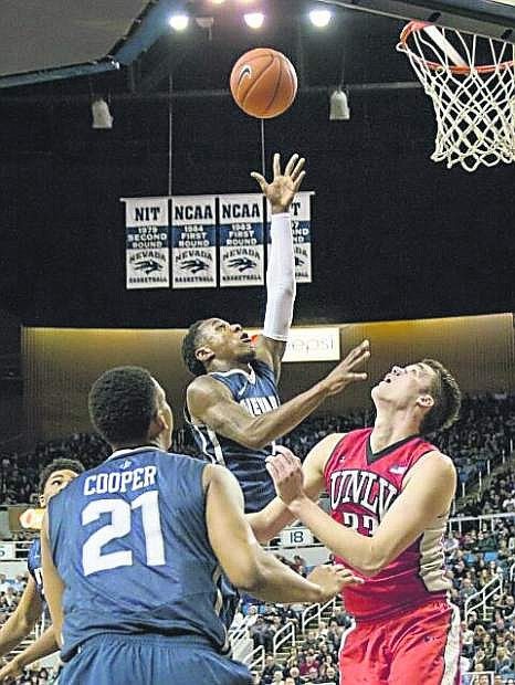 Nevada's Marqueze Coleman takes the ball to the hoop against UNLV Saturday, Jan. 24, at Lawlor Events Center