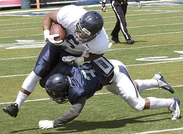 Nevada's Jarid Joseph tackles Don Jackson in the first half of the Silver and Blue game.