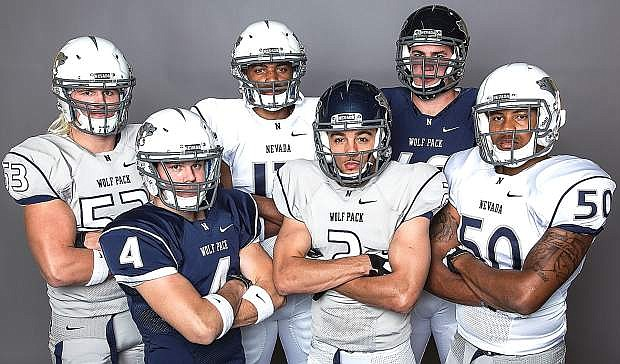 The University of Nevada football team kicked off fall camp on Monday. The Wolf Pack unveiled their new uniforms last week and in the back from left are Brock Hekking, Hasaan Henderson and Brent Roling. Front row from left are Kendall Brock, Richy Turner and Jonathan McNeal.