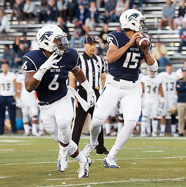 Nevada quarterback Tyler Stewart looks to pass as running back Don Jackson runs a route in the Wolf Pack's win over UC Davis last year at Mackay Stadium.