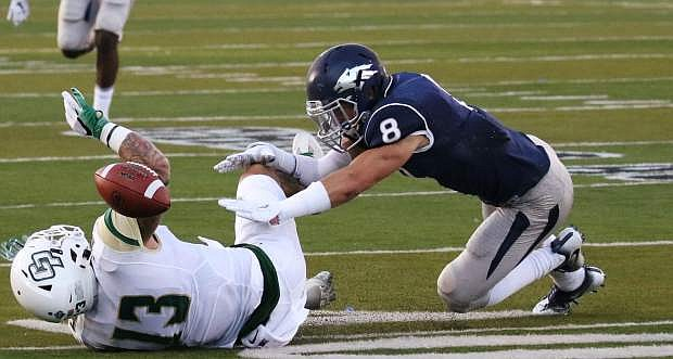 Nevada's D.J. Peluso defends Cal Pol's Jaden Sawyer last week.