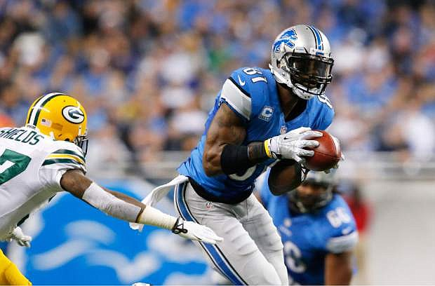 Detroit Lions wide receiver Calvin Johnson (81) pulls away form Green Bay Packers cornerback Sam Shields (37) for a touchdown during the third quarter of an NFL football game at Ford Field in Detroit, Thursday, Nov. 28, 2013. (AP Photo/Paul Sancya)