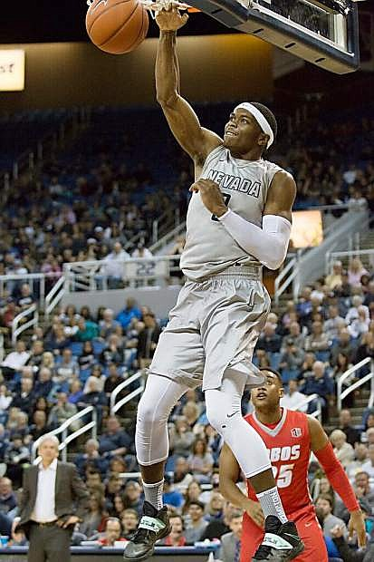 Cameron Oliver dunks for Nevada against New Mexico on Saturday, March 5, at Lawlor Events Center.