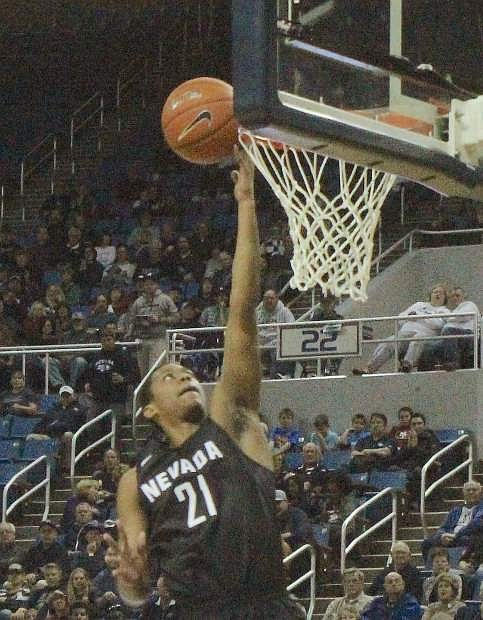 Eric Cooper takes the ball the basket for Nevada Saturday.