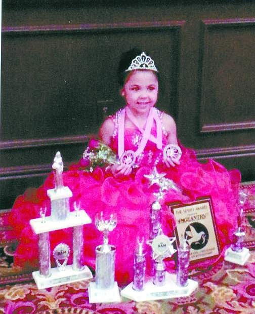 JiaBella Williams was named first runner-up in the junior pre-teen division of the National American Miss pageant.