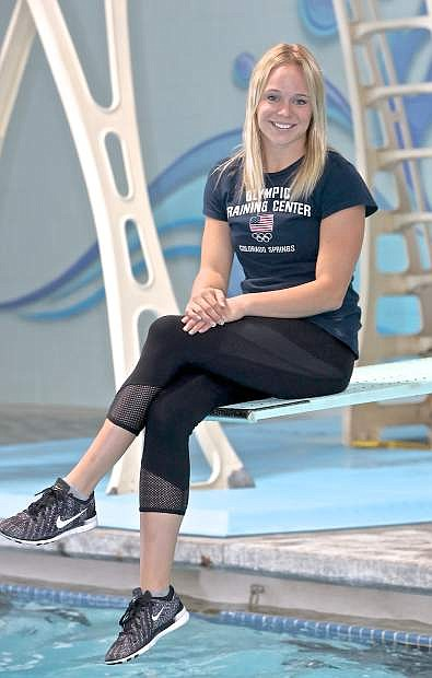 Olympic diving hopeful Krysta Palmer is right at home on the springboard Wednesday at the Carson Valley Swim Center.