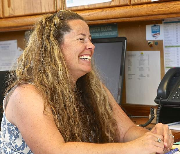 Jennifer Budge is interviewed by Anne Knowles in her office Friday.