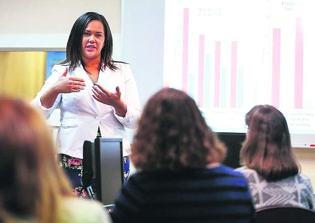 Hannah McDonald, training specialist with Partnership Carson City, speaks to a group of counselors at Carson High School in Carson City, Nev. on Monday, Feb. 8, 2016. McDonald trained counselors on the latest trends in drugs and paraphernalia among youth.