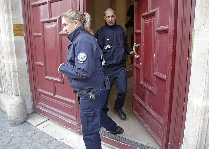 French police officers exit the residence of Kim Kardashian West in Paris Monday, Oct. 3, 2016. Kim Kardashian West was unharmed after being robbed at gunpoint of more than $10 million worth of jewelry inside a private Paris residence Sunday night, police officials said. (AP Photo/Michel Euler)
