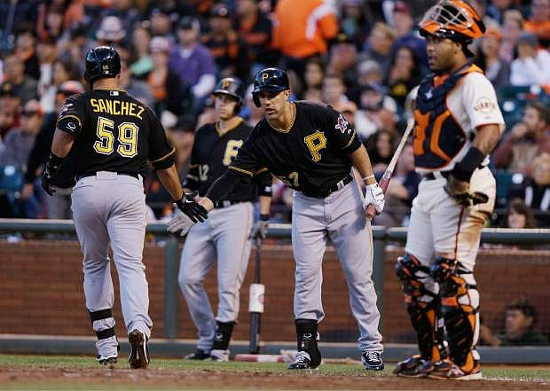 Pittsburgh Pirates' Tony Sanchez (59), left, celebrates his solo home run with teammate Andrew Lambo during the fifth inning of a baseball game against the San Francisco Giants on Saturday, Aug. 24, 2013, in San Francisco. (AP Photo/Marcio Jose Sanchez)