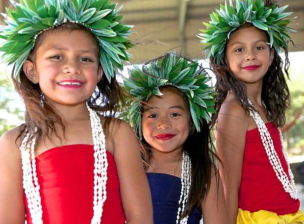 Julie Salanoa, Jaidyn Moliga and Emjae Salanoa pose for a photo before their Polynesian dance routine with the Matasina Dance group Saturday at the Marv Teixeira Pavillion in Mills Park.