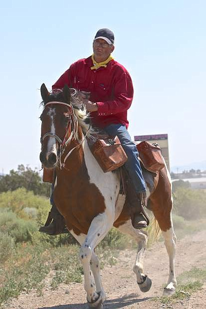 Pony Express rider Rex Hall rides through Mound House Wednesday morning on his way to Carson City.