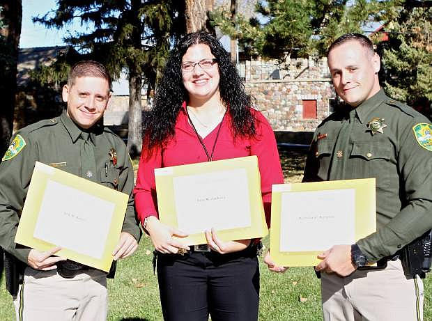 Erin M. Jackson of Carson City Juvenile Probation Services is flanked by CCSO graduates Arik M. Sitton (left) and Nicholas G. Simpson (right) Thursday at POST graduation ceremonies at the Stewart facility.