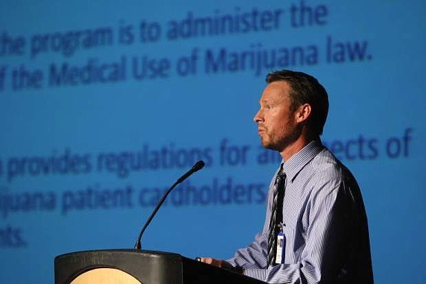 Steve Gilbert, state medical marijuana program manager speaks at a community forum on marijuana dispensaries Monday night.