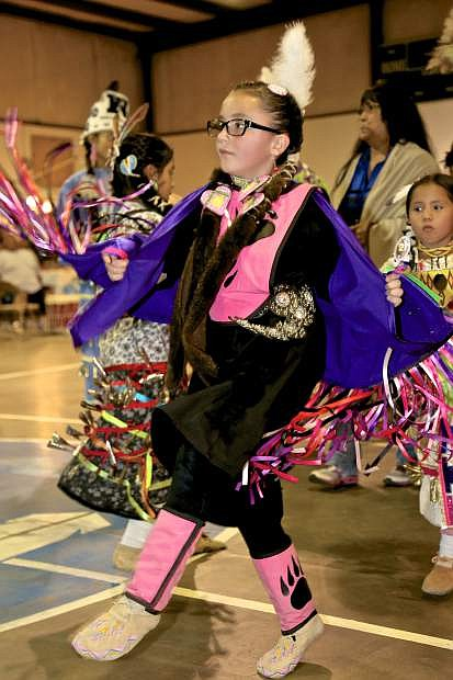 8-year-old Sarah White of the Cheyenne Tribe of Reno dances at the Pow Wow Friday night.