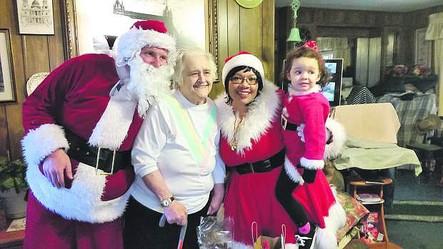 Members of the nonprofit Friends to All deliver Christmas gifts to home bound seniors in Carson City.