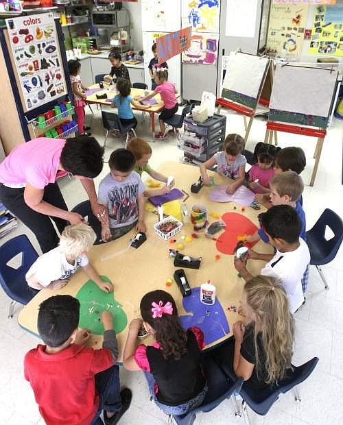 Pre-kindergarten students work on an arts and crafts project during class at MarK Twain Elementary school on Tuesday.
