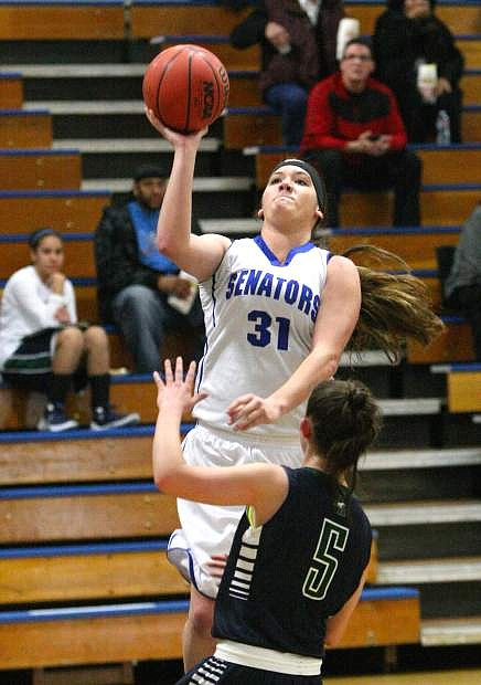 Haley Garver drives to the basket in a game against Damonte Ranch on Tuesday.