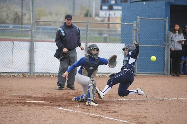 Catcher Malia Tiffer and Damonte Ranch's Emma Covert.