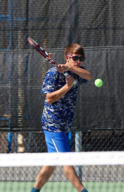 Doubles player Aaron Woodbury, 6-0 with his partner Kyle Kunz, hit a backhand against Wooster on Thursday at Carson High.